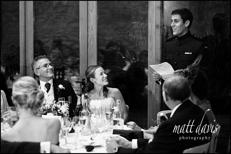 black and white photo of speeches during a winter wedding at Kingscote Barn