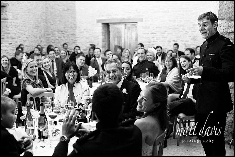 speeches inside Kingscote Barn on a winters day