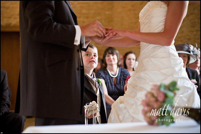 ring exchange during civil ceremony at Kingscote Barn