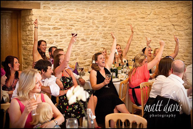 Guests reactions to speeches at Kingscote Barn wedding