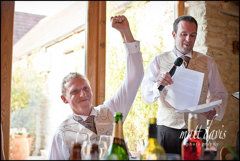 groom reaction to speeches at Kingscote Barn wedding