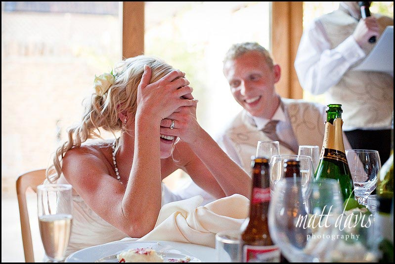 bride reaction to speeches at Kingscote Barn wedding