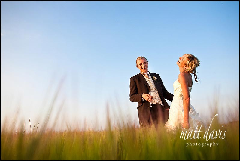 wedding photography in the top field of corn at Kingscote Barn