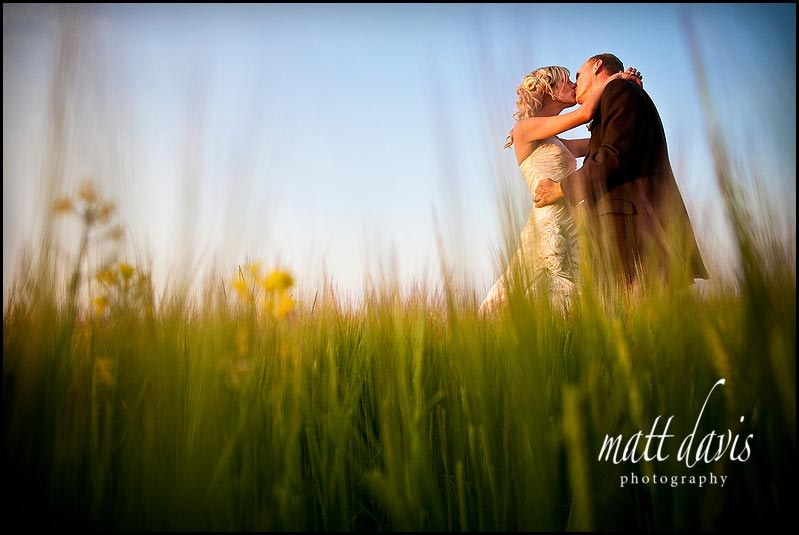 Kingscote Barn wedding photography in a field of corn