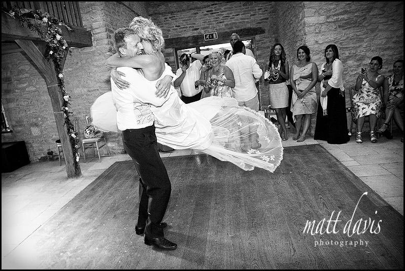 wedding couples first dance at Kingscote Barn wedding