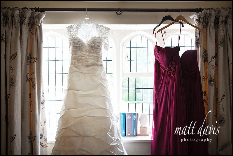 wedding dress hung in the window at Manor House Hotel