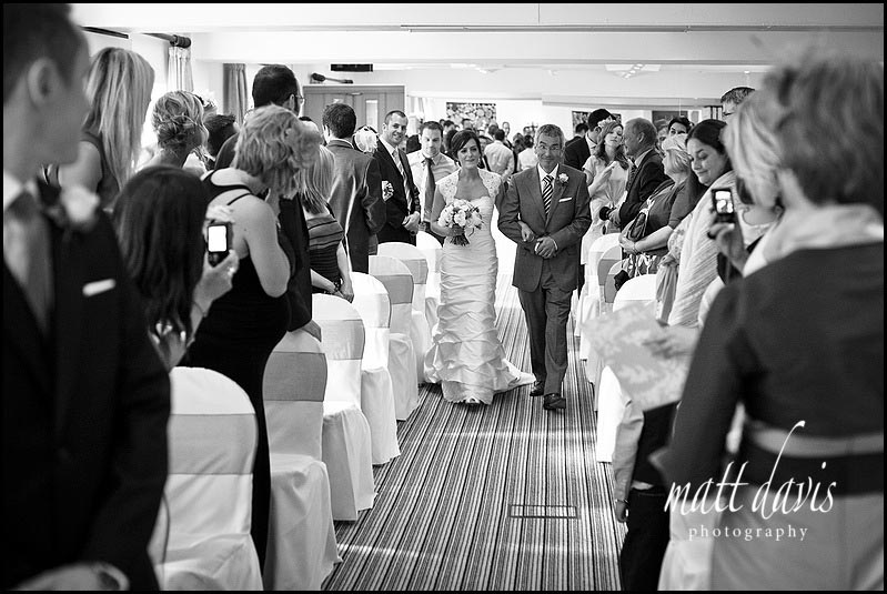 bride walking down aisle at Manor House Hotel