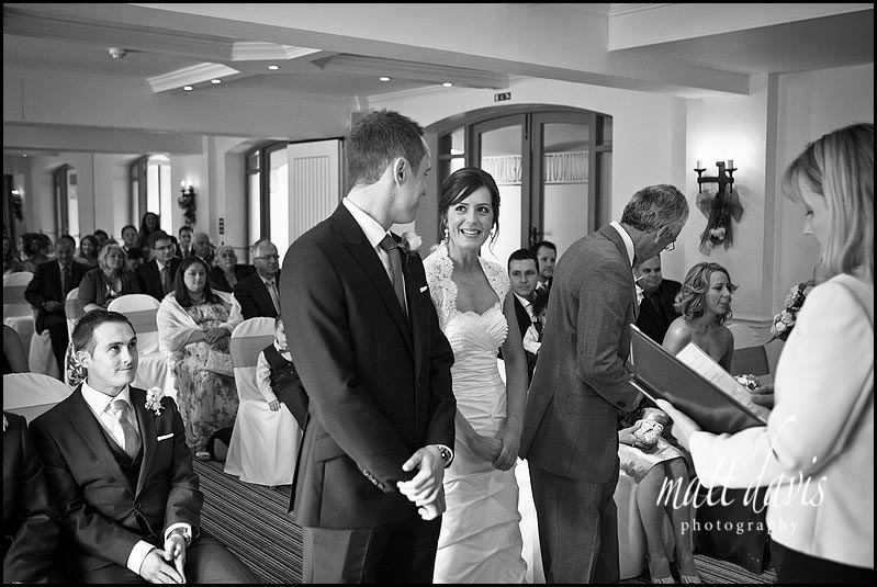 black and white photo of wedding ceremony at Manor House Hotel