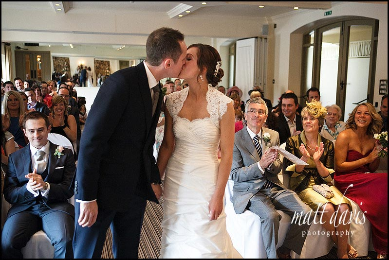 wedding kiss at Manor House Hotel wedding