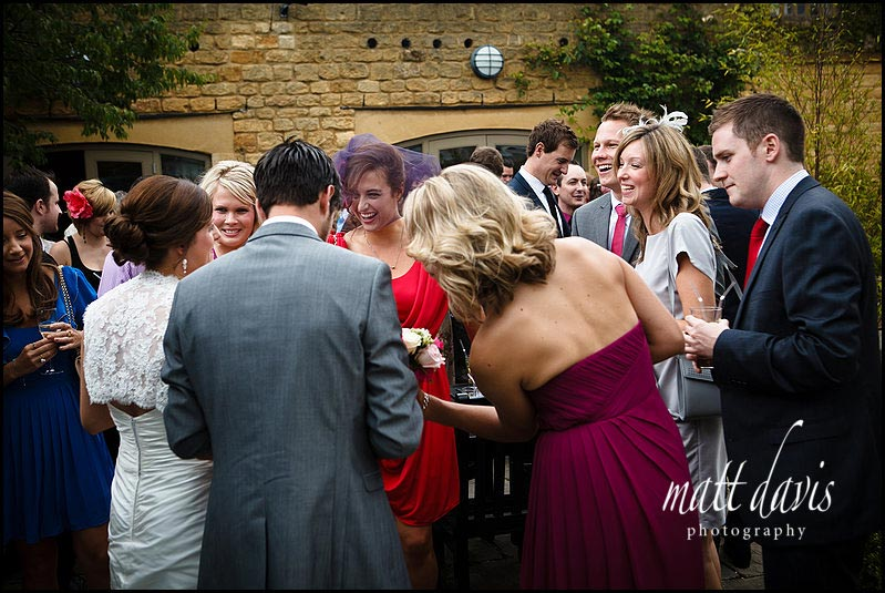 colouful photo of the wedding drinks reception at Manor House Hotel