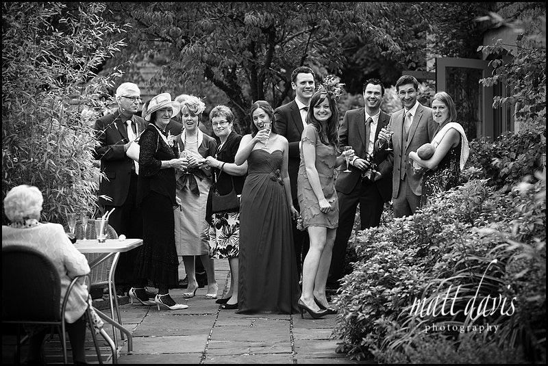 wedding guests watching group photos at Manor House Hotel