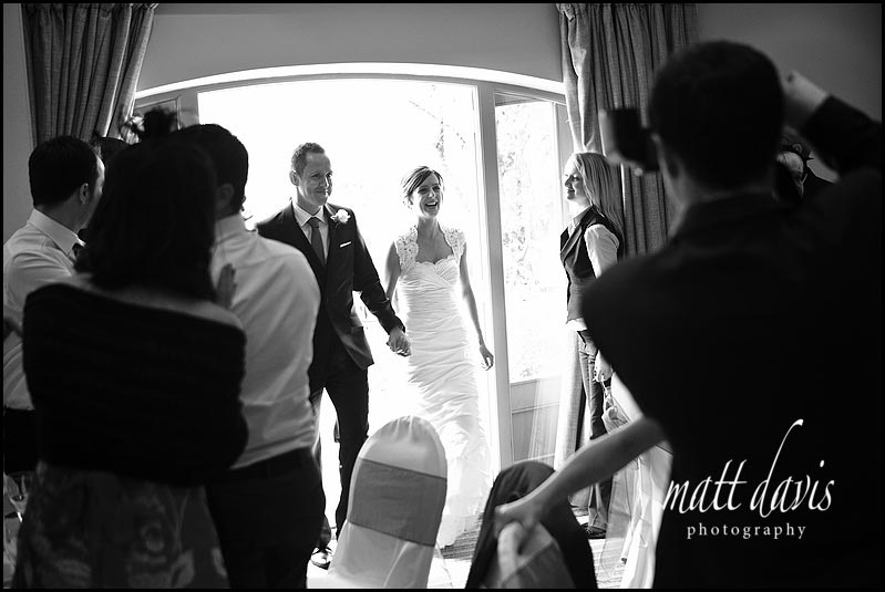 bride and groom entering wedding breakfast at  Manor House Hotel wedding
