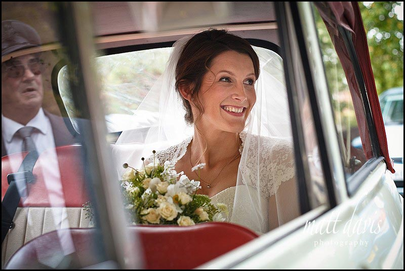 Bride arriving at Ripple church, Gloucestershire