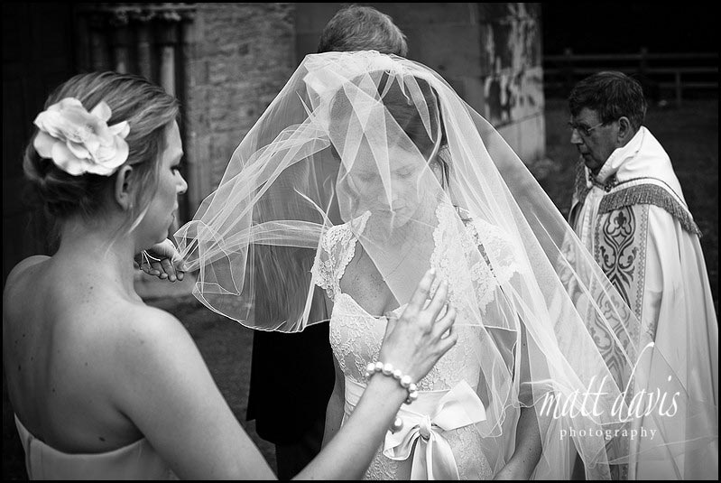 Photo of bride with veil over face