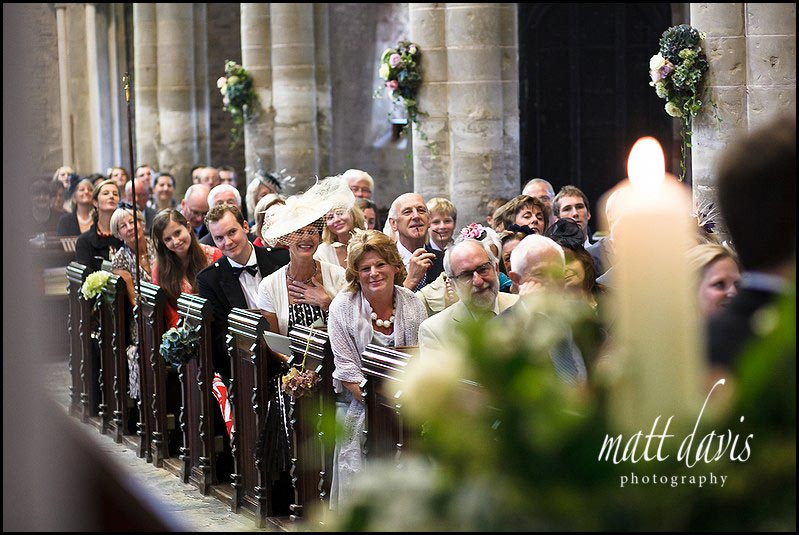 Photography of wedding guests in church