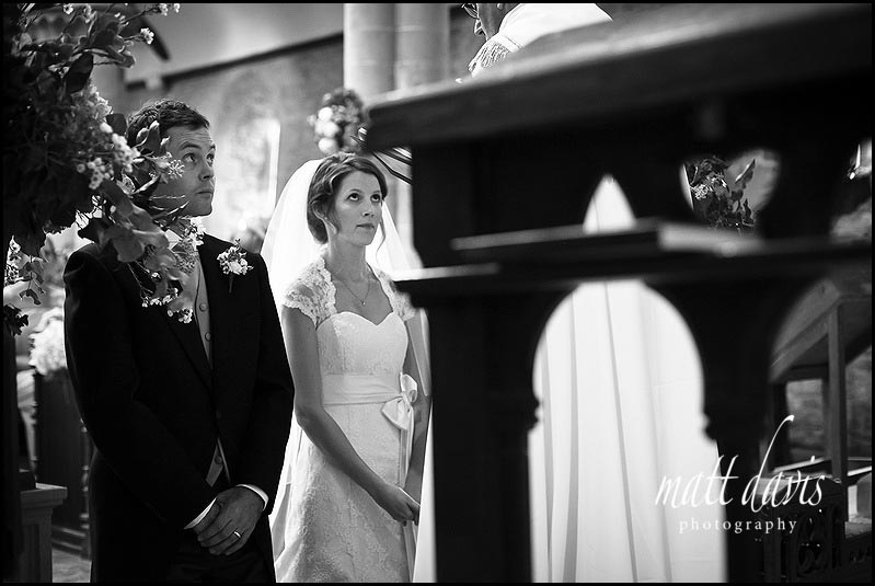 Wedding photo of couple praying in church
