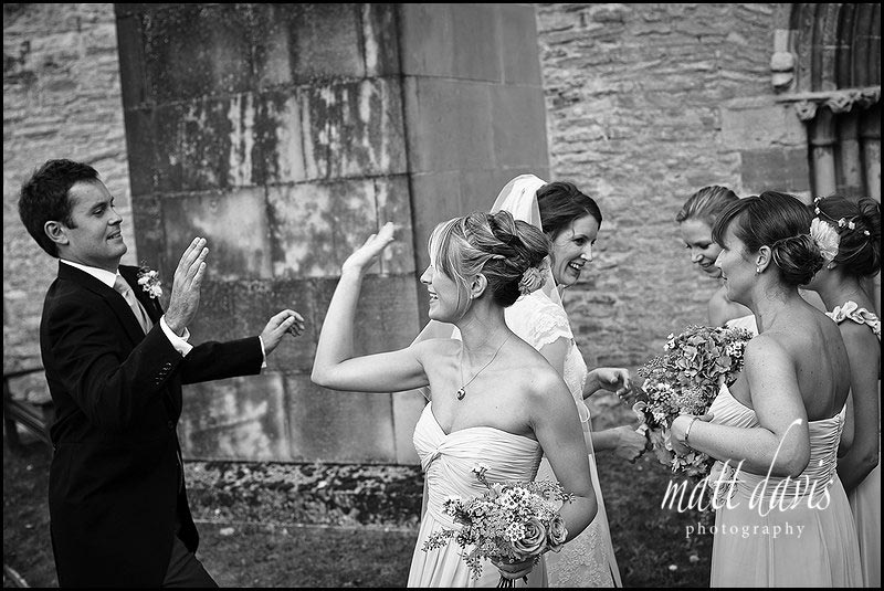 high five photo of groom at wedding