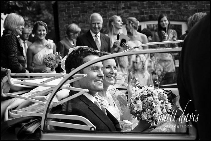 Wedding couple in vintage wedding car
