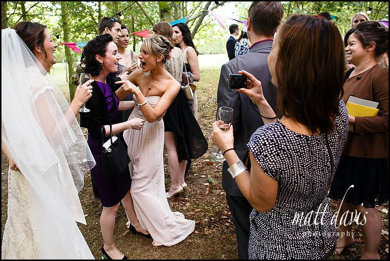 Documentary wedding photography of guests during drinks reception