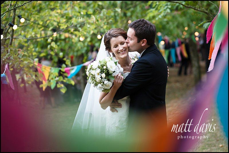 Wedding couple kissing at vintage wedding