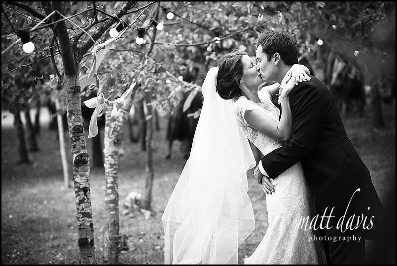 Black and white photo of wedding couple kissing