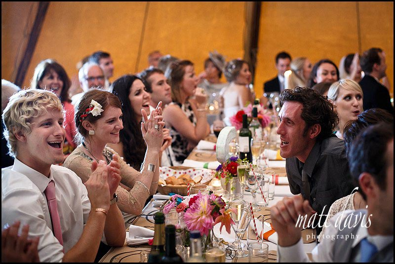 Wedding guests inside tipi at wedding