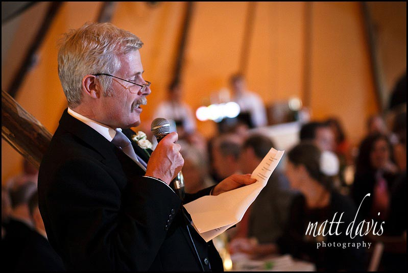 Speeches inside a tipi at wedding