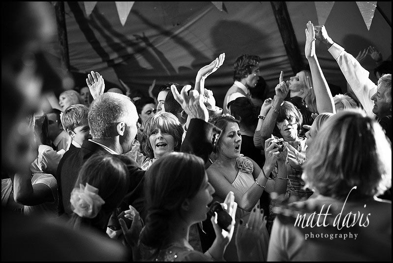 Happy wedding guests dancing