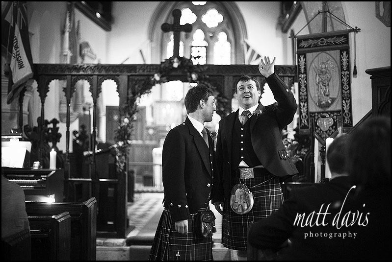 Groom and best man inside Kingscote Church