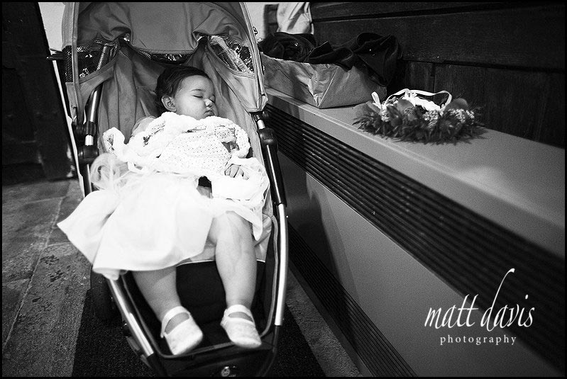 Small bridesmaid asleep in push chair