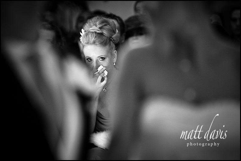 Documentary Wedding Photo of bridesmaid crying