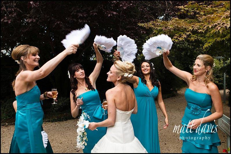 feather fans for bridesmaids at wedding