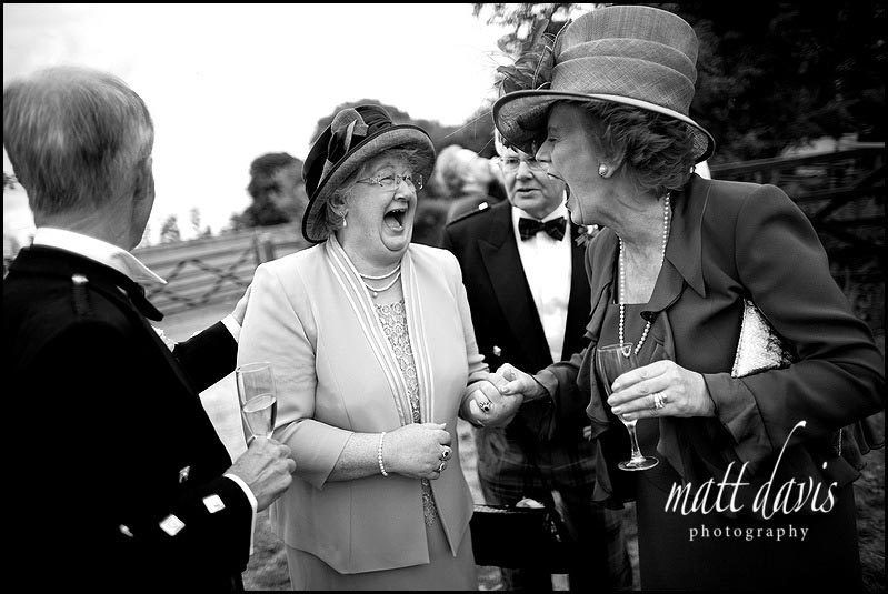 Documentary Wedding Photography of posh wedding guests laughing