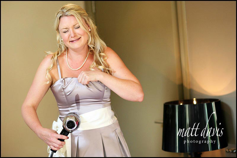 Documentary Wedding Photography of bridesmaid with spillage on her dress