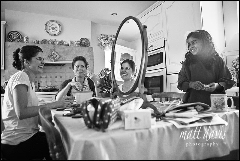 bridesmaids doing make-up before wedding