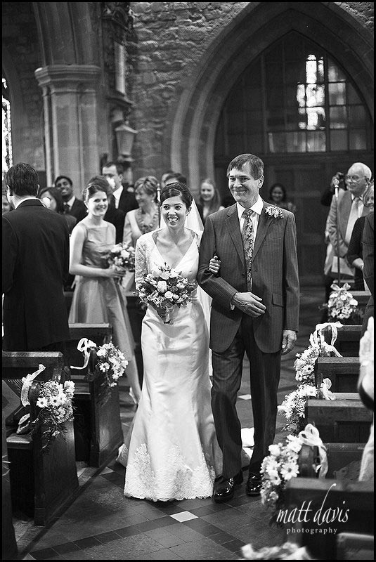bride walking down aisle at St Mary's Church, Prestbury