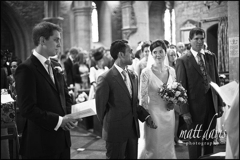 Bride and groom at St Mary's Church, Prestbury, Cheltenham