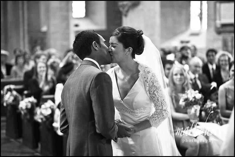 wedding kiss at St Mary's Church, Prestbury, Cheltenham