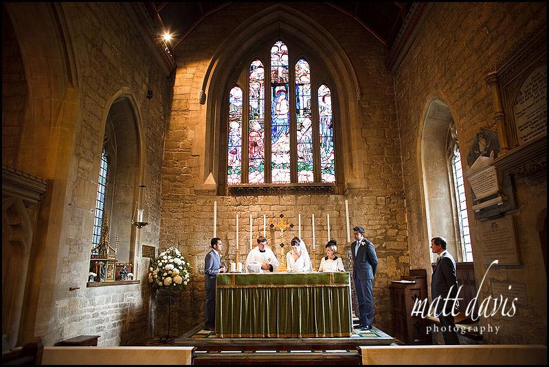 Signing the wedding register at St Mary's Church, Prestbury, Cheltenham