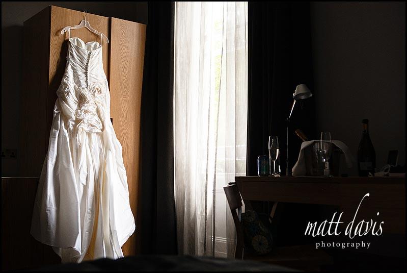 wedding dress hung up on wardrobe