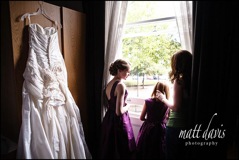 Bridesmaids looking out window