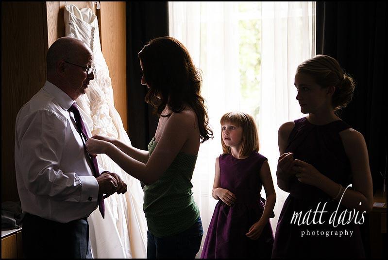 Father of the bride having his tie tied