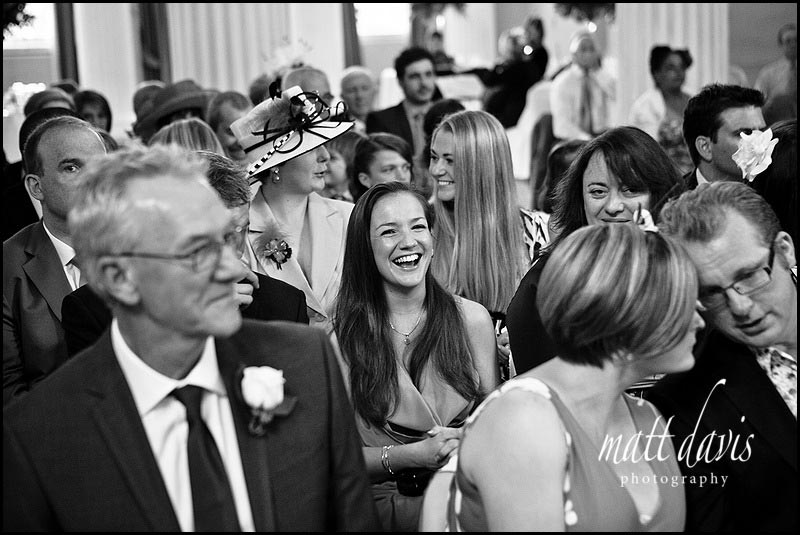 Wedding guests laughing at Pittville pump room wedding