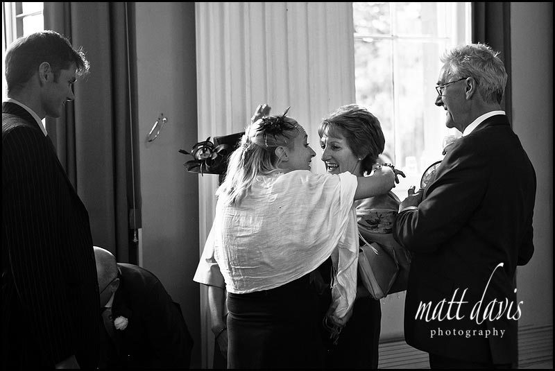 Wedding guests with hat falling off