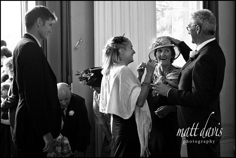 Wedding guest who's hat had fallen off