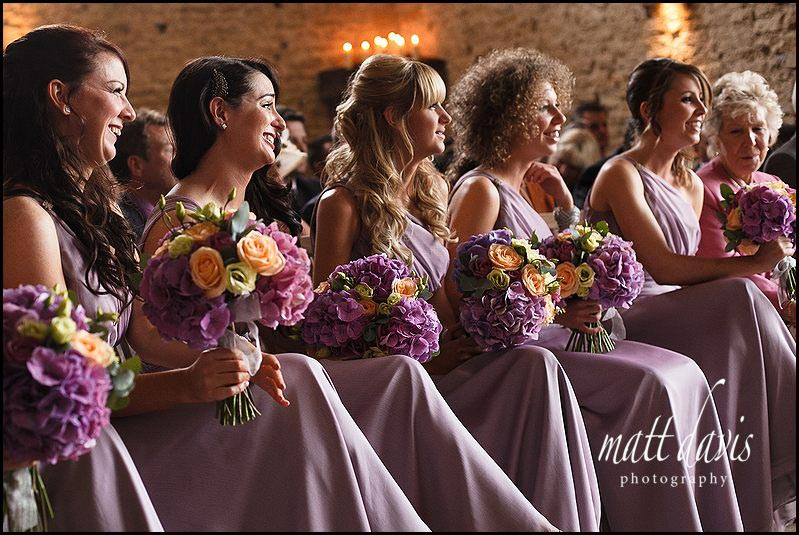 Bridesmaids in matching purple bridesmaid dresses