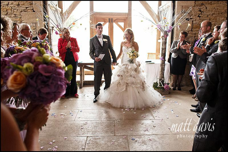 Happy groom with wedding certificate at Cripps Stone Barn