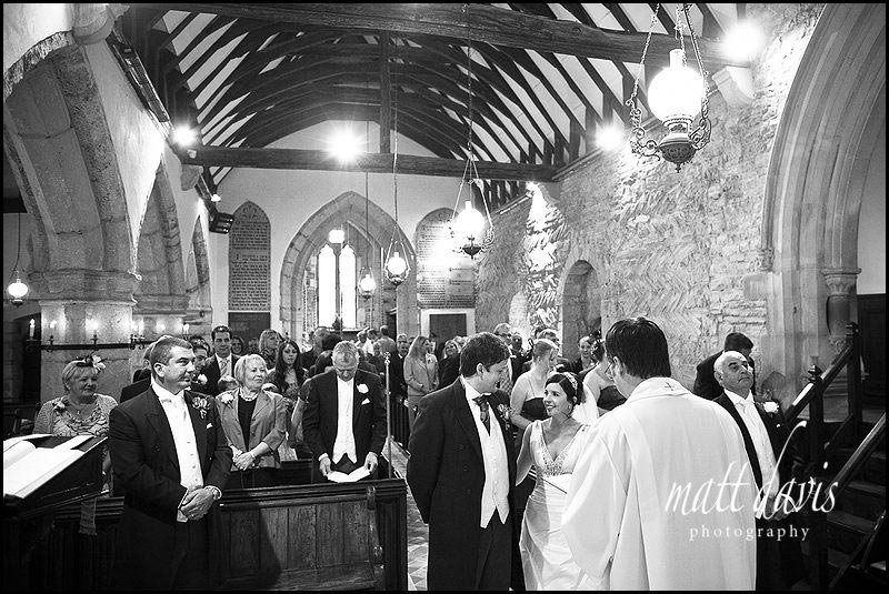 wedding photos at Ashleworth Church, Gloucestershire during the ceremony