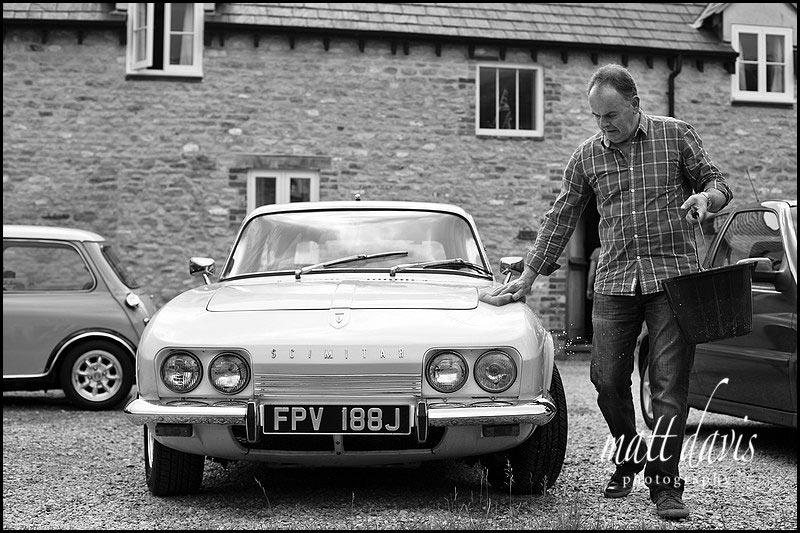 Father of the bride washing wedding car