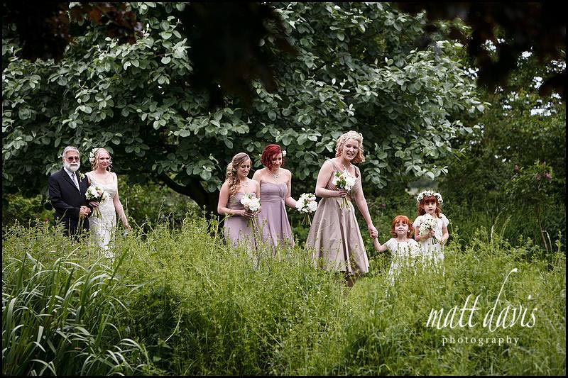 Arrival of bride at outdoor wedding ceremony at Friars Court